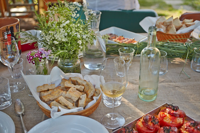 A Tuscan table set for dinner in the evening sun